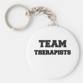 Terapeutas del equipo llavero redondo tipo pin