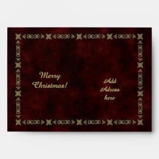 Terciopelo rojo con el ornamento de oro sobres