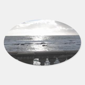 Terrace overlooking the sea oval sticker