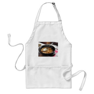 Terracotta bowl with beans . Tuscan typical recipe Adult Apron