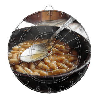 Terracotta bowl with beans . Tuscan typical recipe Dart Board
