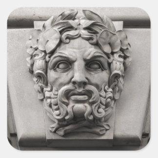 Terracotta Stone Faces on Historic Building Square Sticker