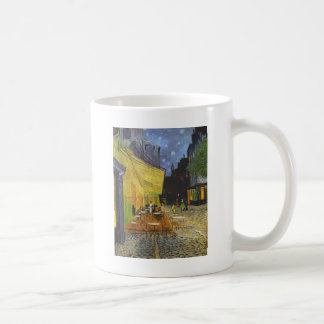 Terraza del café en la noche taza