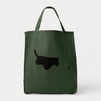 Terrier galés que vaga bolsas