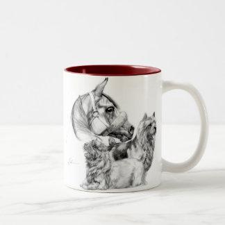 Terrieres de Norwich y taza del caballo