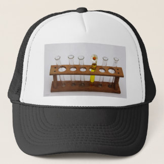 test tubes science lab equipment and flower trucker hat