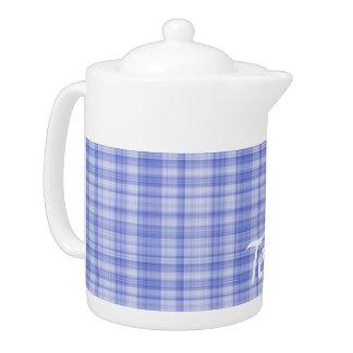 Tetera azul de la tela escocesa