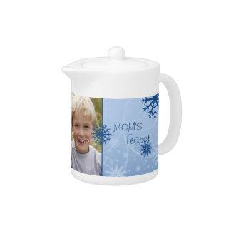 Tetera azul del navidad de la mamá de la foto de l