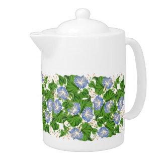 Tetera botánica de las flores florales azules de