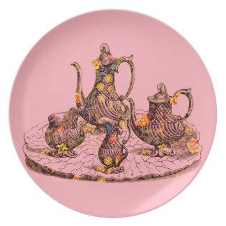 Teteras del vintage en cena rosada/la placa decora plato de cena