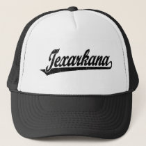 Texarkana script logo in black distressed trucker hat