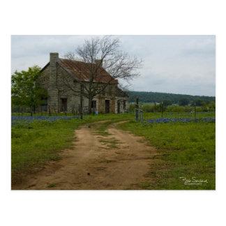 Texas farm house with bluebonnets postcard