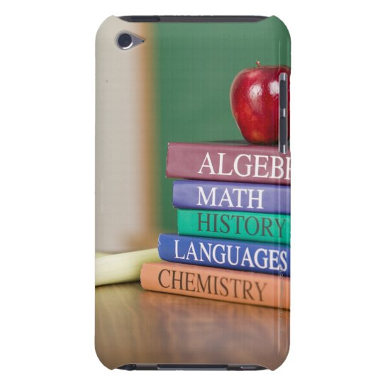 Textbooks and an apple 2 Case-Mate iPod touch case