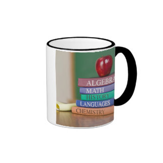 Textbooks and an apple 2 ringer coffee mug
