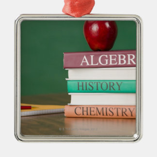 Textbooks and an apple metal ornament