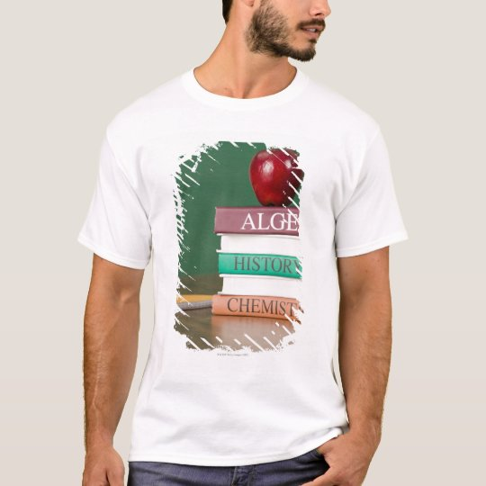 Textbooks and an apple T-Shirt