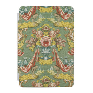 Textile with a repeating floral motif iPad mini cover