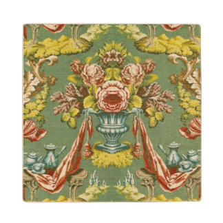 Textile with a repeating floral motif maple wood coaster