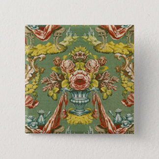 Textile with a repeating floral motif pinback button