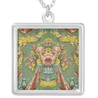 Textile with a repeating floral motif silver plated necklace