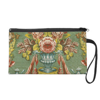 Textile with a repeating floral motif wristlet purse