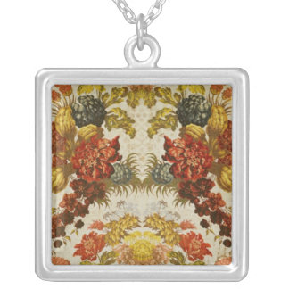 Textile with a repeating floral pattern silver plated necklace