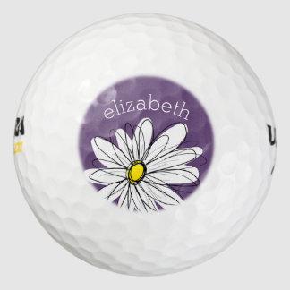 Texto caprichoso púrpura y amarillo del pack de pelotas de golf