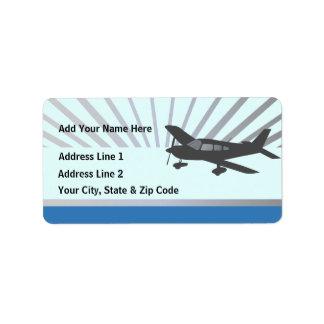 Texto del personalizar - aeroplano del ala baja etiquetas de dirección