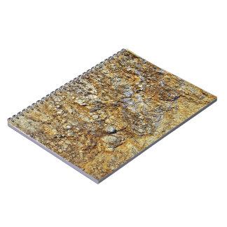 Textura amarilla de la roca libreta espiral