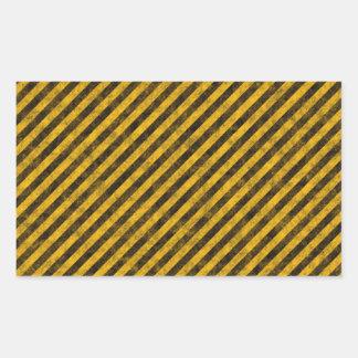 Textura amarilla y negra de las rayas del peligro pegatina rectangular