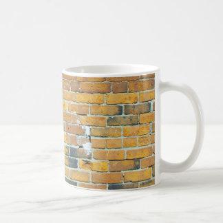 Textura anaranjada de la pared de ladrillo del vin tazas