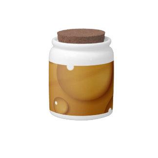 Textura anaranjada del descenso del agua jarras para caramelos