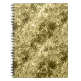 Textura arrugada bronce libro de apuntes con espiral