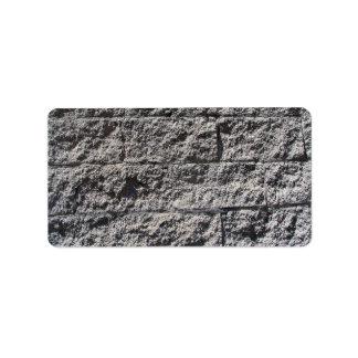 Textura áspera de la pared de piedra etiqueta de dirección