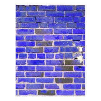 Textura azul brillante de la pared de ladrillo del postal