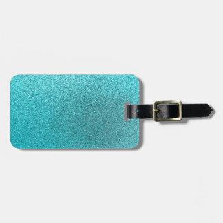Textura azul de la chispa del fondo del brillo del etiqueta para maleta
