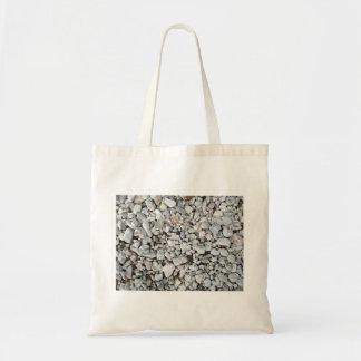 Textura blanca y gris de la grava bolsas