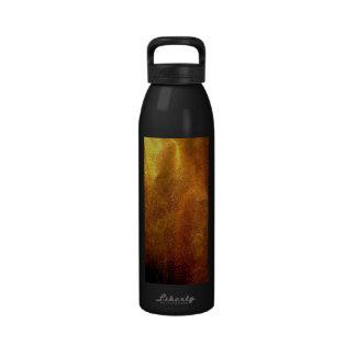 Textura brillante del papel de la tinta del oro botellas de beber