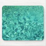 Textura coloreada aguamarina del agua tapetes de raton