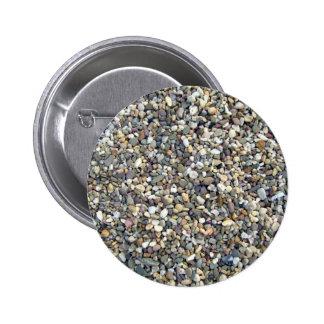 Textura colorida de las piedras del guijarro pins