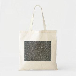 Textura concreta con las pequeñas piedras bolsas de mano