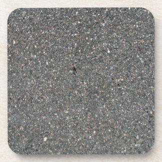 Textura concreta con las pequeñas piedras posavasos de bebida