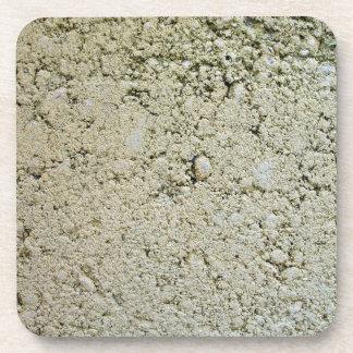 Textura concreta de la piedra caliza posavasos de bebida