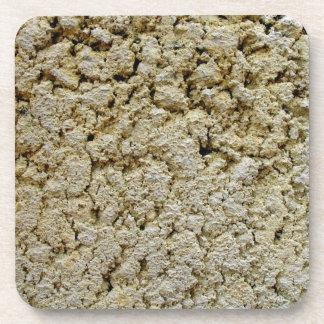 Textura concreta de la piedra caliza posavasos de bebidas