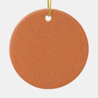 Textura de color salmón de la tela adorno navideño redondo de cerámica