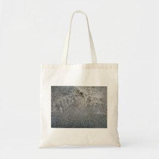 Textura de la arena y de piedras grises bolsa
