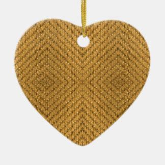 Textura de la materia textil adorno navideño de cerámica en forma de corazón