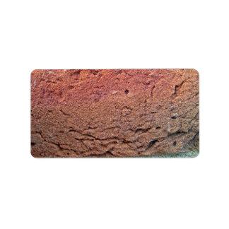 Textura de la pared de ladrillo etiquetas de dirección