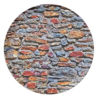 Textura de la pared de piedra plato