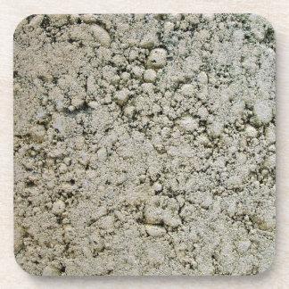 Textura de la superficie concreta de la piedra cal posavasos
